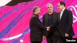 حسن هاشمی وزیر بهداشت و محمدعلی جعفری فرمانده سپاه