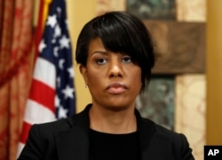 FILE - Mayor Stephanie Rawlings-Blake prepares to speak to the media at City Hall in Baltimore, May 1, 2015.