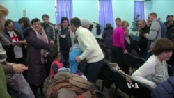 Fearful Ukrainian Refugees Try to Get on With Life