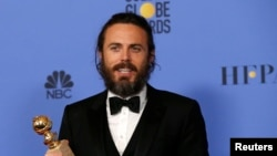 "FILE - Casey Affleck holds the award for Best Performance by an Actor in a Motion Picture - Drama for his role in ""Manchester by the Sea"" during the Golden Globe Awards in Beverly Hills, California, Jan. 8, 2017."