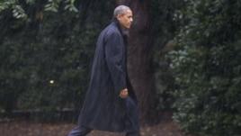 President Barack Obama walks toward White House after cancelling campaign rally, Washington, Oct. 29, 2012.
