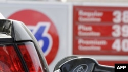 Gas prices are posted in Santa Cruz, Calif., Monday, March 7, 2011. Pump prices have jumped an average of 39 cents per gallon since the Libyan uprising began in mid-February, forcing motorists to pay an additional $146 million per day for the same amount