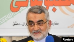 FILE - Alaeddin Boroujerdi, head of the Iranian parliamentary committee for national security and foreign policy, speaks during a news conference at the Iranian Embassy in Damascus Feb. 26, 2014, after his meeting with Syria's President Bashar al-Assad.