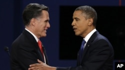 Republican presidential nominee Mitt Romney and President Barack Obama shake hands after the first presidential debate at the University of Denver, Wednesday, Oct. 3, 2012, in Denver.