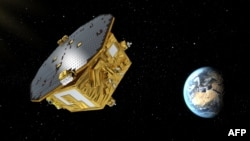 This image from the European Space Agency on Nov. 29, 2015, shows an artist's rendering of the LISA Pathfinder, designed to test technology for future gravitational-wave observatories in space.