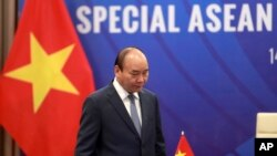 Vietnamese Prime Minister Nguyen Xuan Phuc walks to his desk ahead of the Special ASEAN summit on COVID-19 in Hanoi, Vietnam Tuesday, April 14, 2020. ASEAN leaders and their counterparts from China, Japan and South Korea hold the summit online to…