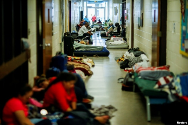 People are seen inside a shelter run by Red Cross before Hurricane Florence comes ashore in Grantsboro, N.C., Sept. 13, 2018.