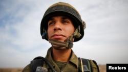 Yussef Salluta, 20, an Israeli Arab soldier takes part in a drill near Kissufim in southern Israel Nov. 29, 2016.