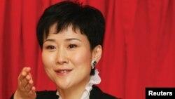 中国前总理李鹏的女儿李小琳参加记者会(2014年1月22日)