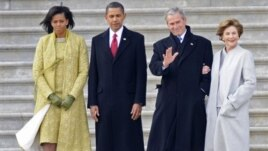 Michelle and Barack Obama walk with George W. Bush and wife, Laura, on Inauguration Day 2009