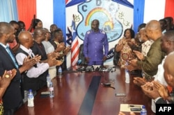 Former international soccer star George Weah is applauded as he arrives to speak to the press in the Liberian capital, Monrovia, on Dec, 30, 2017, the day after Liberia's elections board officially certified Weah as the winner of the nation's presidential election.