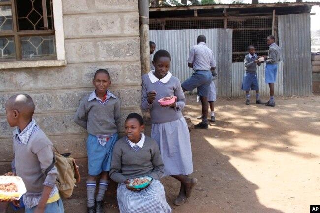 Pupils take a break at Mariakani Primary School in Nairobi, Kenya, July 27, 2015.