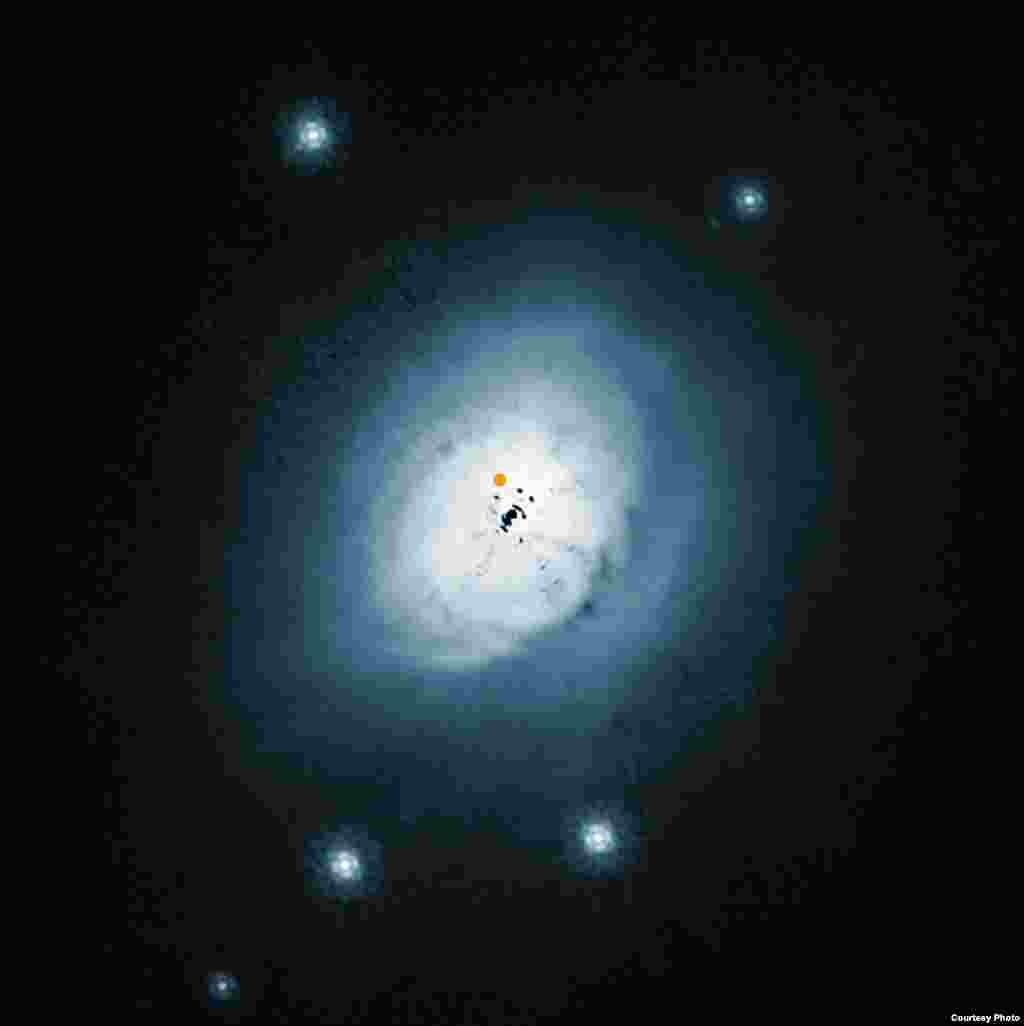 Imagem do telescópio Hubble mostra uma luz visível na parte exterior da poeira ao redor da jovem estrela HD100546.