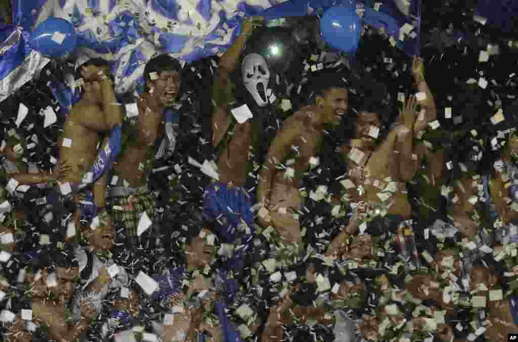 Ecuador's Emelec fans cheer for their team during a Copa Sudamericana soccer match in Guayaquil, Ecuador.