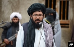FILE - Mullah Mohammed Rasool, the newly-elected leader of a breakaway faction of the Taliban, speaks during a gathering in Farah province, Afghanistan.