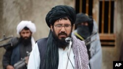 Mullah Mohammed Rasool, the newly-elected leader of a breakaway faction of the Taliban, speaks during a gathering in Farah province, Afghanistan, Nov. 3, 2015. A spokesman on Nov. 14 denied reports that his deputy has been killed.