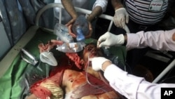 Medics attend to an injured anti-government protester at a hospital in Taiz, April 8, 2011