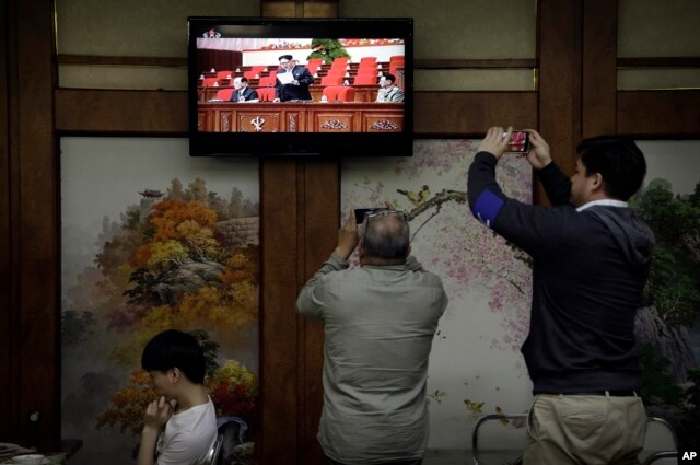 FILE - Restaurant diners watch a broadcast of the seventh congress of the Workers' Party of Korea on local television, where North Korean leader Kim Jong Un is seen delivering a speech, in Pyongyang, May 6, 2016.