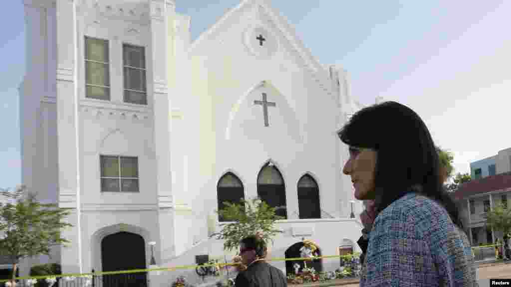 South Carolina Governor Nikki Haley walks between television interviews outside the Emanuel African Methodist Episcopal Church in Charleston, South Carolina, June 19, 2015.