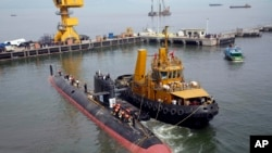 The INS Kalvari, one of the six Scorpene diesel-electric attack submarines, is set afloat at the naval dockyard in Mumbai, India, Thursday, Oct. 29, 2015.