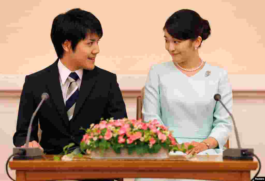 Princess Mako, the elder daughter of Prince Akishino and Princess Kiko, and her fiancee Kei Komuro, a university friend of Princess Mako, smile during a press conference to announce their engagement at Akasaka East Residence in Tokyo, Japan, Sept. 3, 2017