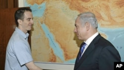 In this photo released by the Israeli Government Press Office Ilan Grapel (l) is greeted in Jerusalem by Israel's Prime Minister Benjamin Netanyahu, Oct. 27, 2011