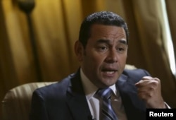 FILE - Guatemala's President-elect Jimmy Morales speaks during a interview with Reuters, Guatemala City, Oct. 26, 2015.
