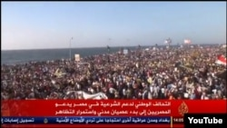 FILE - A screenshot of Al Jazeera showing anti-government protests in the Egyptian port city of Alexandria on Aug. 30, 2013.