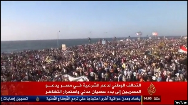 A screenshot of Aljazeera channel showing anti-government protests in the Egyptian port city of Alexandria on Aug. 30, 2013. The protests were not covered by Egyptian TV channels.