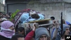 ການແຫ່ສົ່ງສະການໃນເມືອງ Homs, ຊີເຣຍ ວັນທີ 8 ກຸມພາ 2012.