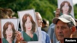 На акции протеста в день убийства Натальи Эстемировой в Москве. 16 июля 2009 г.