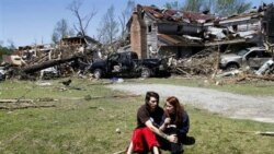 Nathaniel Ramey comforts Megan Hurst at her grandmother's house in Askewville, North Carolina, after a tornado on Saturday