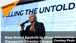 Dmitry Kiselev is seen at the announcement of the creation of the new media brand, Sputnik, in this screengrab from the Sputnik website.