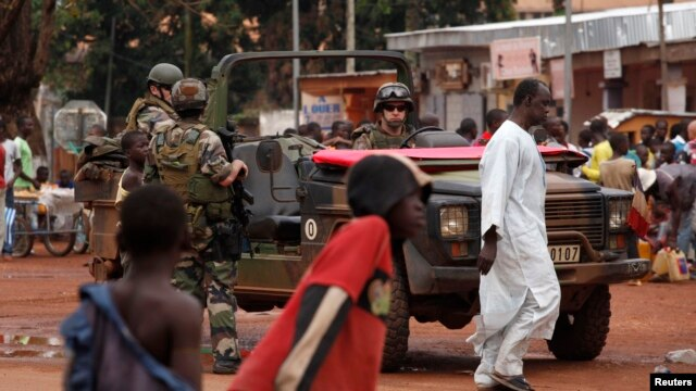 French soldiers patrol Bangui, Central African Republic, where they are trying to prevent a civil war, Dec. 13, 2013.