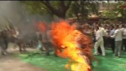 A Tibetan has set himself on fire at a protest in India's capital ahead of a visit by China's president