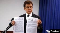 Honduran opposition candidate Salvador Nasralla displays documents filed with Honduran election officials during a news conference in Washington, U.S., Dec. 19, 2017.