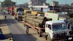 Trucks stand stranded at Raxaul, in East Champaran district of India's Bihar state, near the India-Nepal border, October 15, 2015.