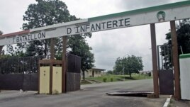 The entrance to an army base camp that was the scene of recent fighting in Abidjan, Ivory Coast, August 6, 2012.