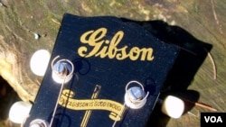 This banner appeared on Gibson guitars during World War II.
