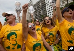 FILE - Demonstrators wear jerseys with the face of Judge Sergio Moro, who is heading the Petrobras investigation, as they protest on Copacabana beach in Rio de Janeiro, Brazil, March 13, 2016.