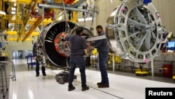 FILE - Technicians build LEAP engines for jetliners at a new, highly automated General Electric (GE) factory in Lafayette, Indiana, March 29, 2017.