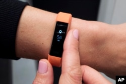 FILE - Fitbit's new Alta HR device is displayed in New York, March 1, 2017. The Pentagon is doing a broad review of how military forces use exercise trackers and other wearable electronic devices.