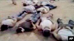 Foto yang diambil dari video amatir dan dirilis oleh Shaam News Network menunjukkan jenazah 13 orang dengan tangan terikat di belakang tubuh dan mata tertutup di Deir el-Zour, Suriah (29/5).