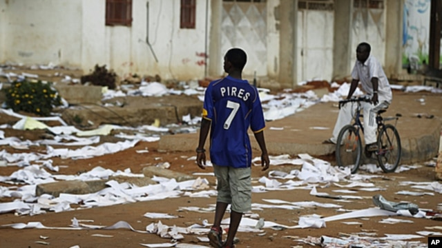 A Senegalese youth walks past the ransacked office of state electrical company Senelec in the capital Dakar, June 28, 2011