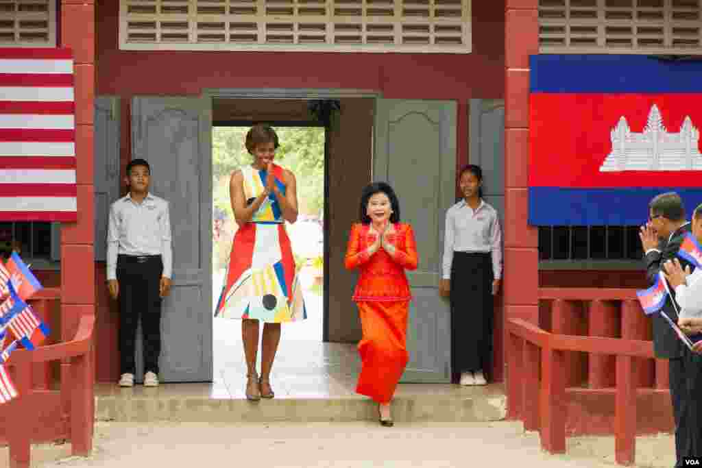 Michelle Obama arrived with her Cambodian counterpart, Bun Rany, at Hun Sen Prasat Bakong Hight School, outside Siem Reap, March 21, 2015.