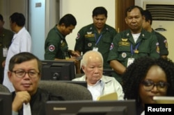 Former Khmer Rouge head of state Khieu Samphan sits in the courtroom of the Extraordinary Chambers in the Courts of Cambodia (ECCC) while awaiting a verdict on charges of genocide on November 16. He was found guilty and sentenced to life in prison. (ECCC handout via Reuters)