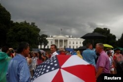People gather in front of the White House during a Fourth of July Independence Day protest in Washington, D.C., July 4, 2019.