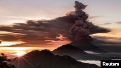 Mount Agung volcano spews smoke and ash in Bali, Indonesia, Nov. 26, 2017.