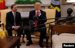 U.S. President Donald Trump meets with Sweden's Prime Minister Stefan Lofven, left, in the Oval Office at the White House in Washington, March 6, 2018.