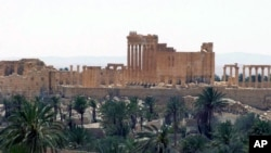 Pemandangan kota Palmyra, sebuah kota kuno yang terkenal dengan reruntuhan zaman Romawi dan tercatat sebagai salah satu situs warisan budaya dunia UNESCO.